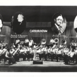 Orchestra conducted by Dr. Lynn B. Dana.