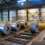 Steel is rolled into coils and banded, then the coils are picked up by a crane and loaded onto trucks or locomotive gondolas.  They are then sent to automotive factories and other plants and manufacturers.  These coils are in the galvanizing department warehouse at WCI, Severstal.