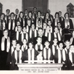 The combined senior, junior and children's choirs of the Magyar Presbyterian Church with Reverend Zoltan Szabo.