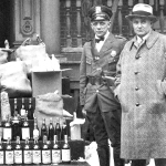 Warren Police pose with confiscated liquor on the steps of the old Trumbull County Jail on High Street NW following a raid on bootleggers.