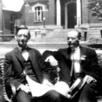 Lynn Dana and William Hert, with the public library in the background.