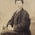 Unidentified portrait of seated man.