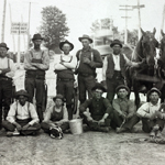 Group photo of men, horses and dogs in the Hubbard area.