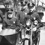 Warren police officers and motorcycle.