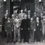 First deacons and elders of the Magyar Presbyterian Church on the church steps.