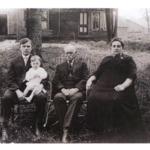 Kee family photo taken in yard.