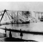 Barn on fire at the Market Street Bridge, during the flood of 1913.